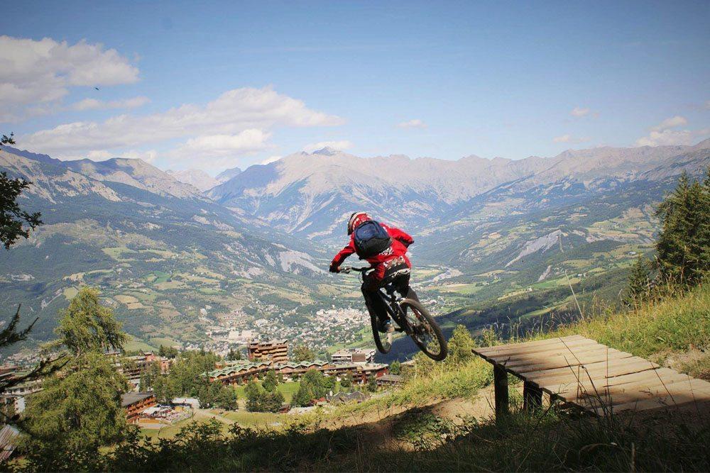 Hitting a jump in the Pra Loup Bikepark
